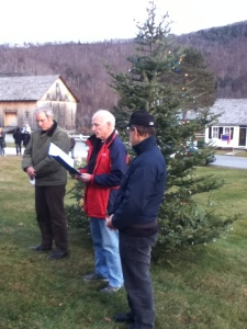 Plymouth Memory Tree Lighting by Michelle Pingree. Pieter Bowen (L), Al Poirier, & Robert Fishman - Memory Tree board members, reading names submitted for the Memory Tree list of remembrance.