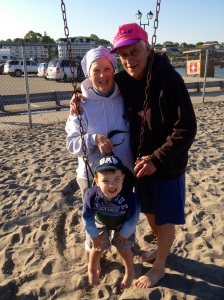 Margo & Tom Marrone with grandson, Owen, in ME. Photo by Melissa Perrino.