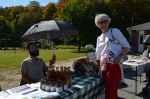 Plymouth State Rep Alison Clarkson visits the Farm & Wilderness table