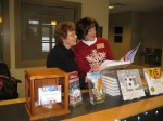 Shirley Billings and Cathy Lee looking at Gesine's book