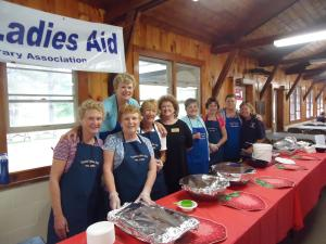 Carol Coyne (2nd from left) and Ladies Aid friends serve strawberry shortcake at the annual Strawberry Festival, June 2015.